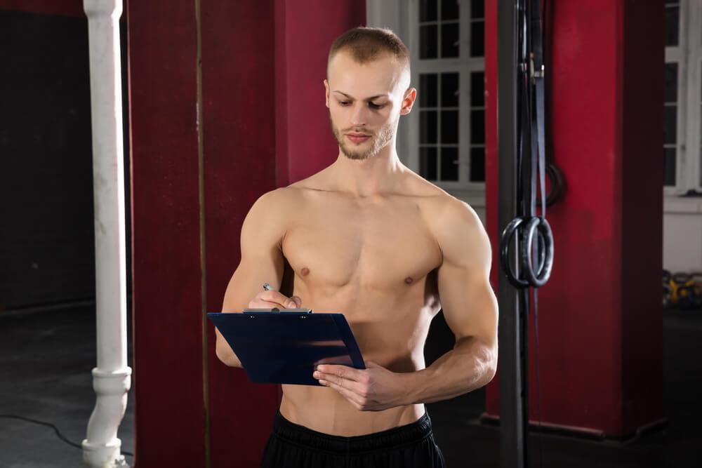 Man keeping a workout log